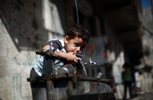 Boy drinking from a water fountain (Mohammed Abed/AFP via Getty Images)