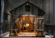Miniature barn depicting man hanging from noose (State Dept./S.L. Brukbacher)