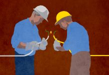 Illustration of an older electrician showing a younger one how to splice a cable (State Dept./Doug Thompson)