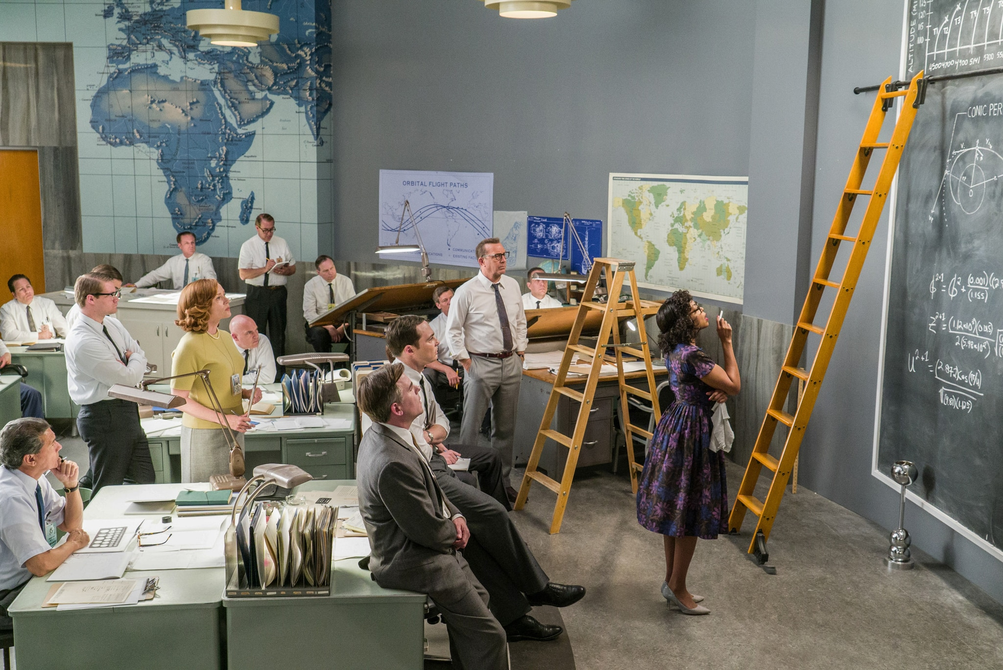 Movie scene featuring people in office looking at large blackboard (© Hopper Stone/Twentieth Century Fox)