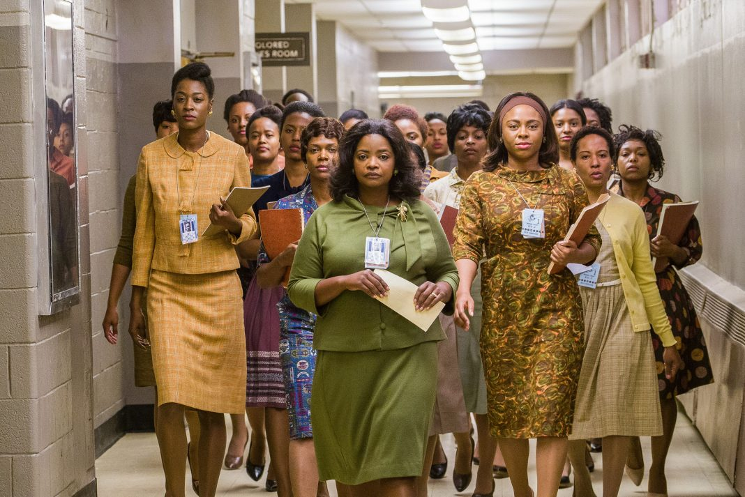 Movie scene showing crowd of women walking down hallway (© Hopper Stone/Twentieth Century Fox)