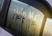 The words 'Help me' written into condensation on car window (© Thinkstock)