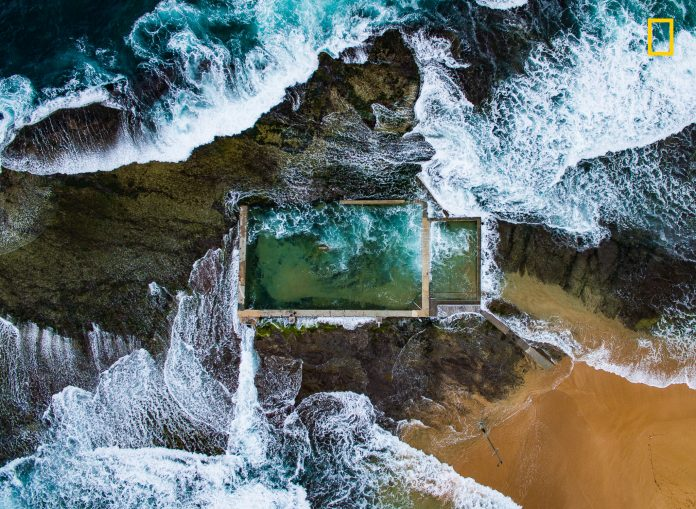 Aerial view of pool surrounded by waves and rocks (© Todd Kennedy/2017 National Geographic Nature Photographer of the Year)
