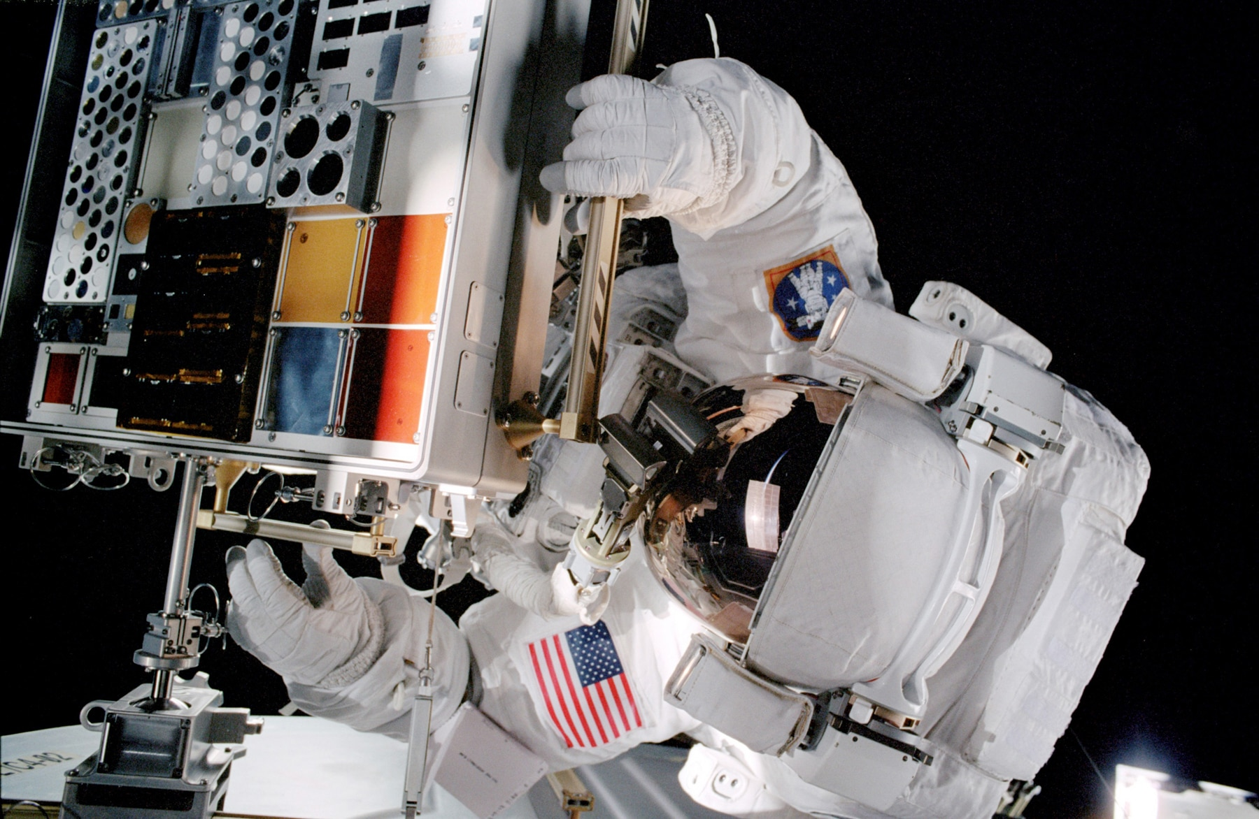 Astronaut working on equipment in space (NASA)
