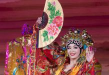 Chinese woman in costume holding fan (White House)