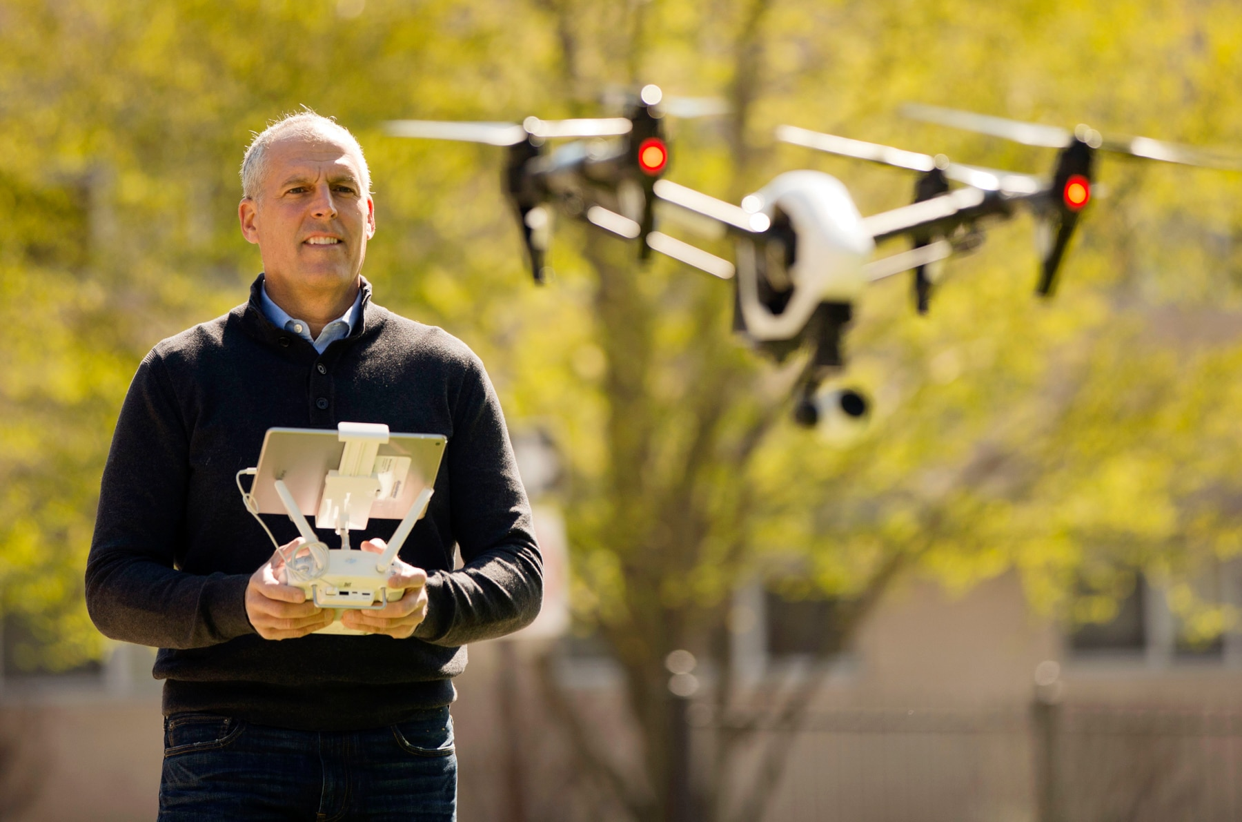 Man flying a drone (© AP Images)