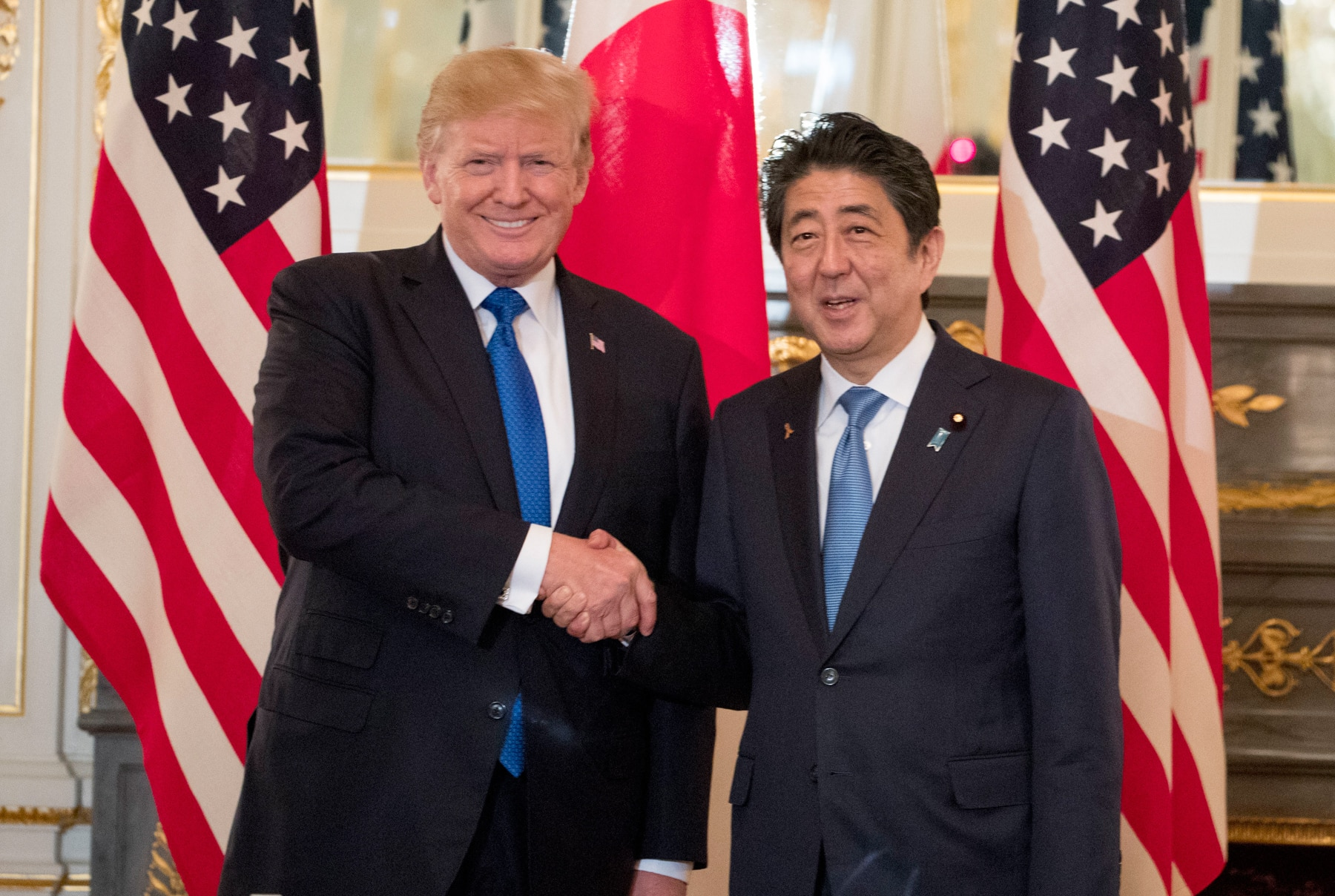 President Trump and Japanese Prime Minister Shinzō Abe shaking hands (© AP Images)