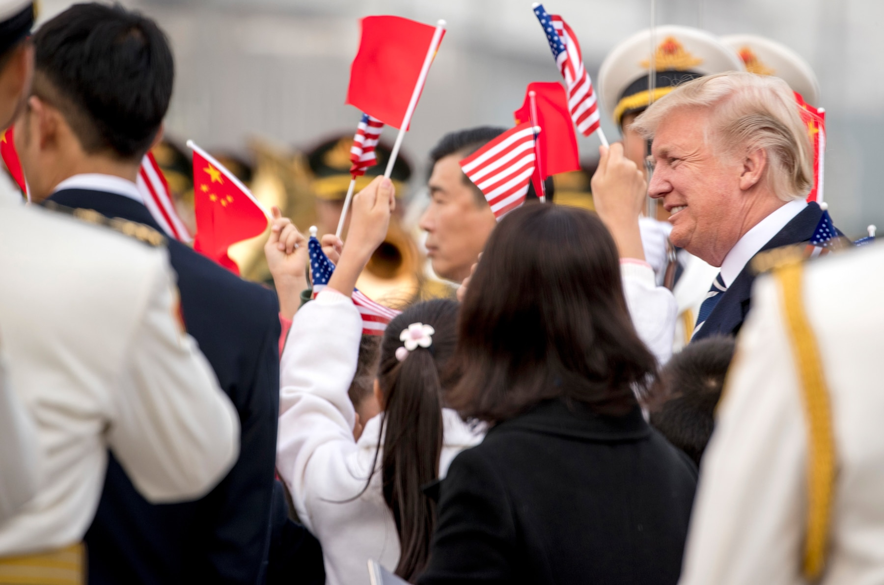 Children waving U.S. and Chinese flags (© AP Images)