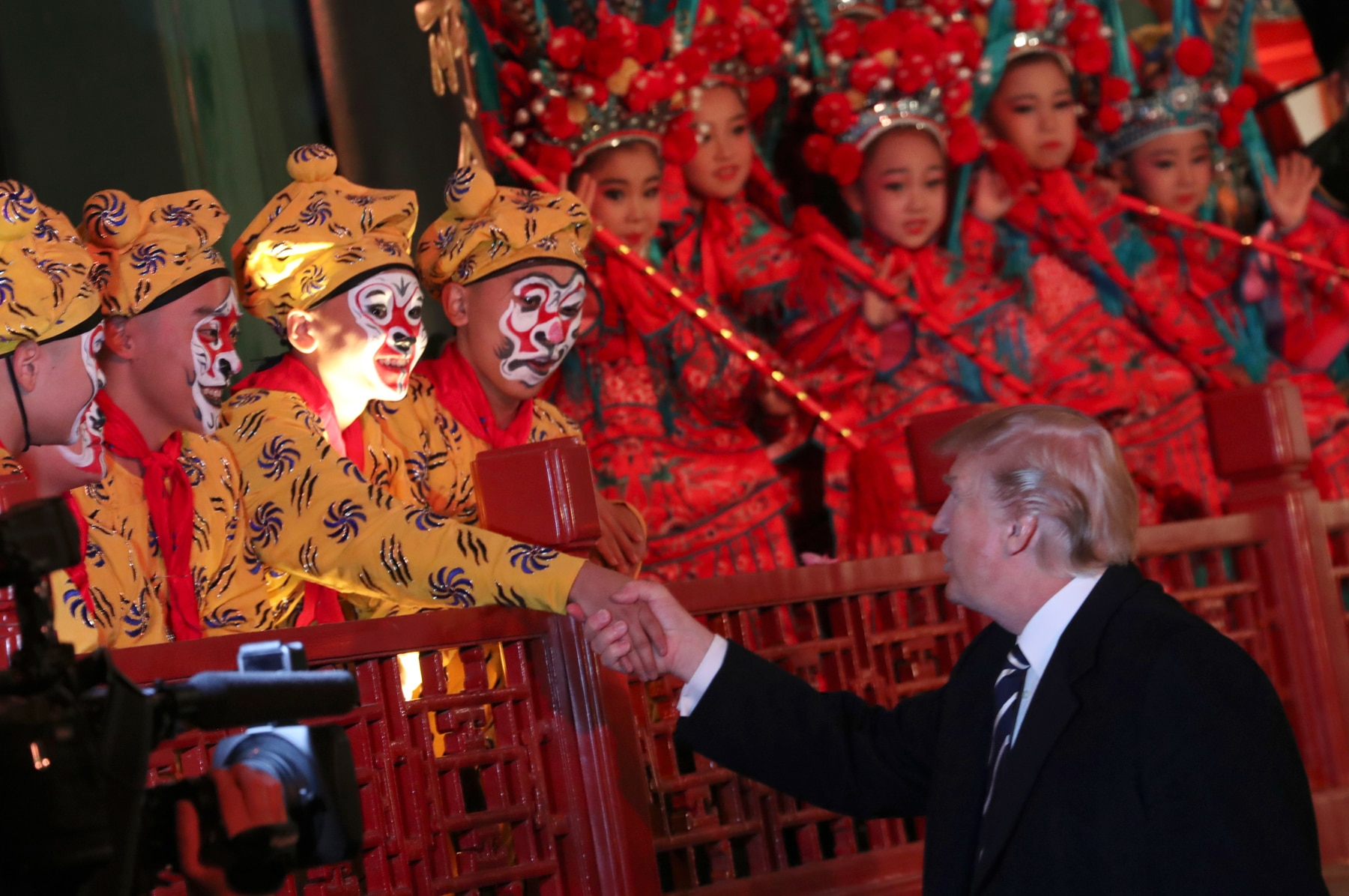 President Trump shaking hands with opera performers (© AP Images)