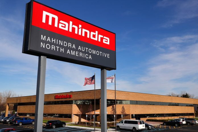 Mahindra sign outside large building (© AP Images)