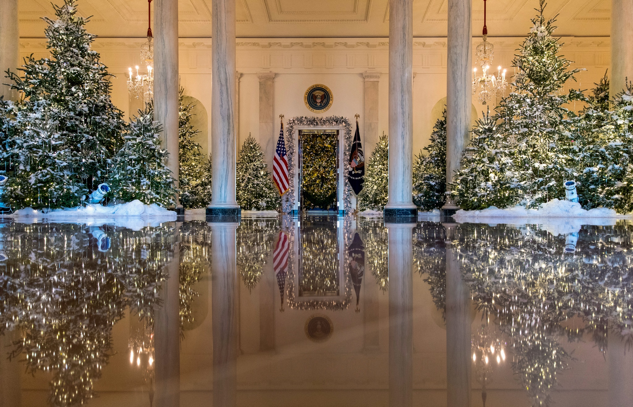 Grand Foyer decorated with Christmas trees and artificial snow (© AP Images)