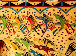 Brightly colored painting depicting people on horseback (© Danita Delimont/Alamy)
