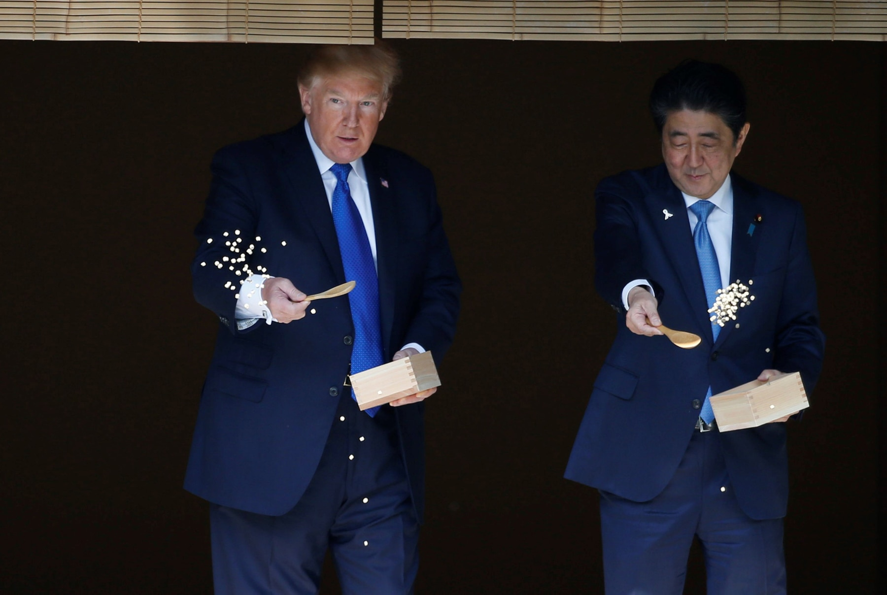 President Trump and Prime Minister Abe feeding fish (© Toru Hanai/Andalou Agency/Getty Images)