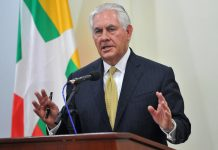 Tillerson talking at lectern (© Aung Htet/AFP/Getty Images)