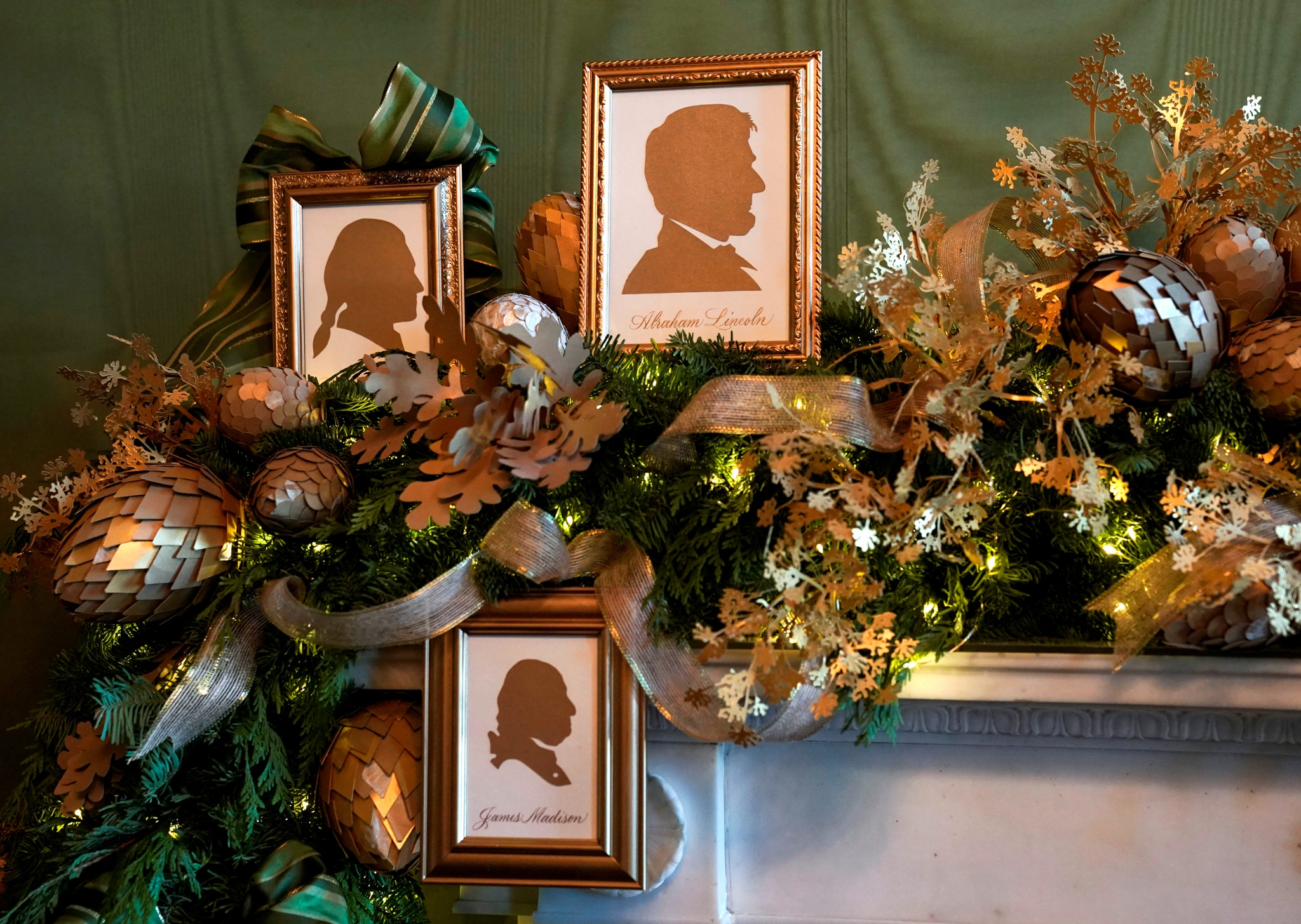Decorated mantel with three framed presidential silhouettes (© Kevin Lamarque/Reuters)