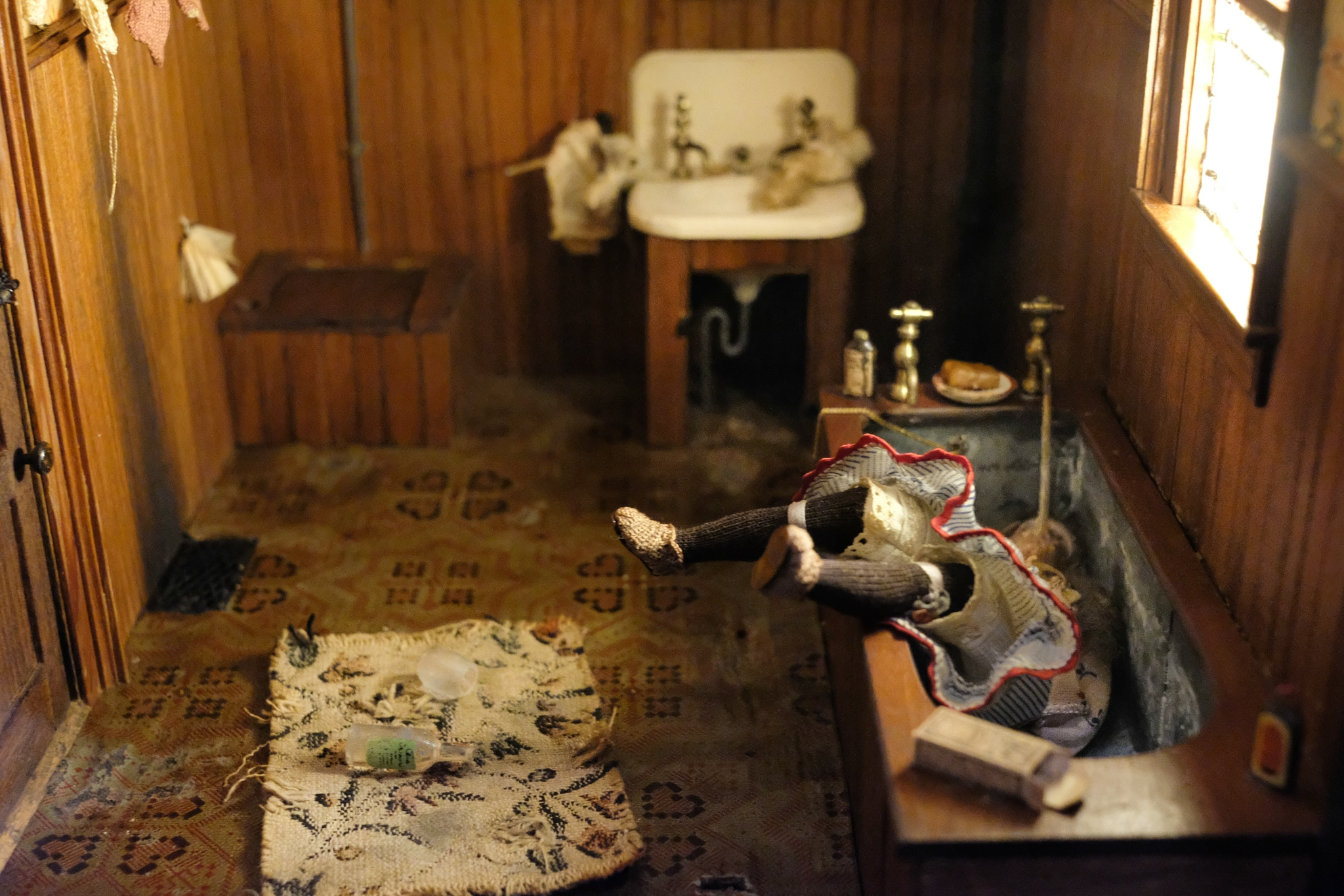 Miniature scene of woman drowned in bathtub (State Dept./S.L. Brukbacher)