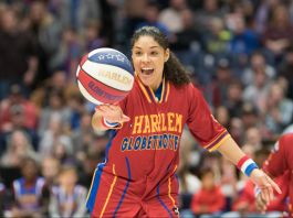 Basketball player spinning ball on her fingers (© Brett Meister/Harlem Globetrotters)