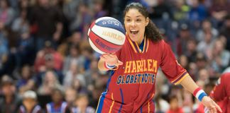 Basketball player spinning ball on her fingers (© Brett Meister/Harlem Globetrotters)