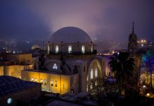 Domed synagogue at night (© AP Images)