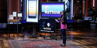 Young woman standing and speaking in front of large TV screens (© Michael Desmond/ABC/Getty Images)