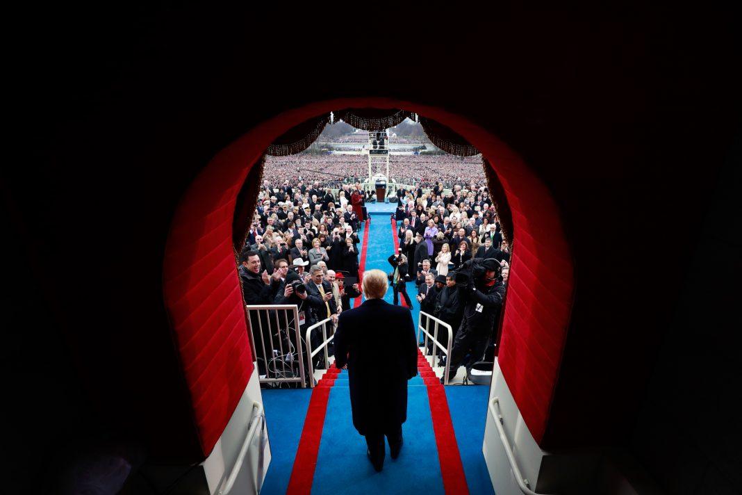Man standing in ornate doorway facing crowd (© Doug Mills/Getty Images)