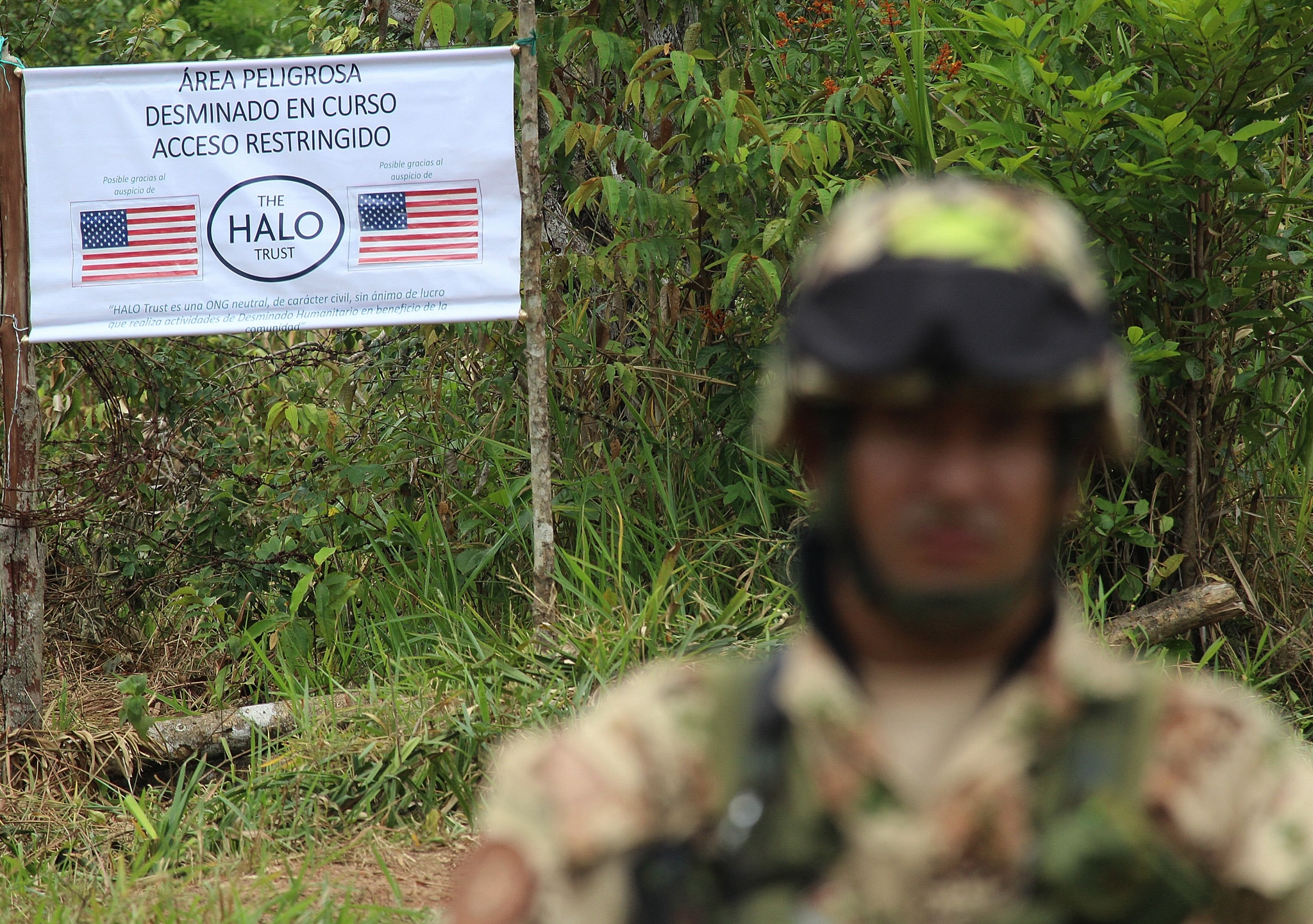 Soldier in front of sign declaring area off-limits (© STR/AFP/Getty Images)