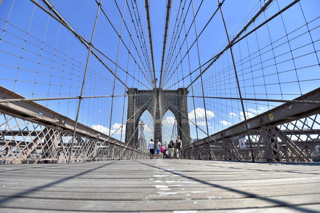 People walking along bridge (© Loic Venance/AFP/Getty Images)