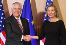 Rex Tillerson and Federica Mogherini shaking hands in front of flags (© Dursun Aydemir/Anadolu Agency/Getty Images)