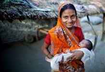 Woman holding baby (Paul Joseph Brown/GAPPS)