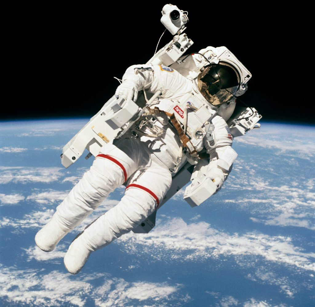 Astronaut floating in space above Earth (NASA)