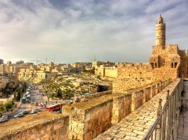 View of old city looking down from stone wall with tower (Shutterstock)