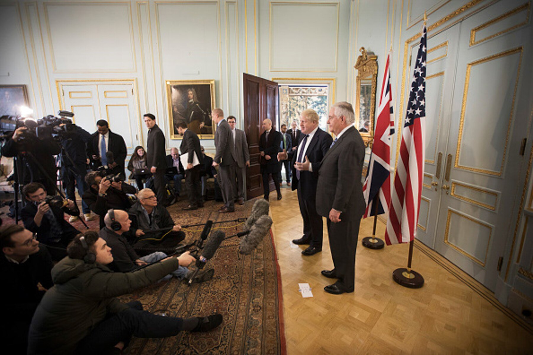 Boris Johnson and Rex Tillerson standing on podium in front of people holding microphones (© Jack Hill/WPA/Getty Images)