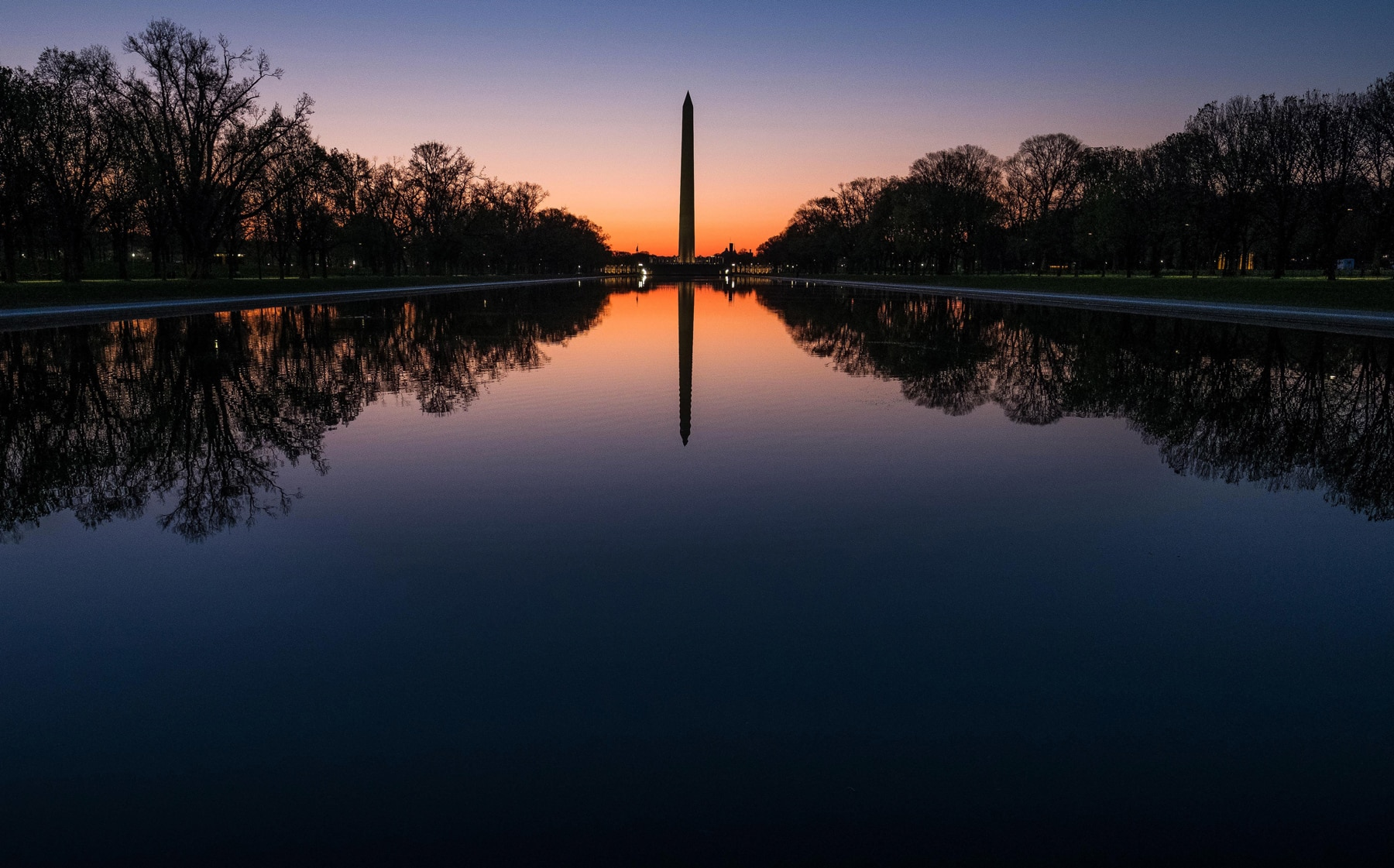 Washington Monument mirrored in Reflecting Pool (© AP Images)