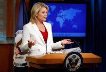 Heather Nauert at lectern, with map behind her (© AP Images)