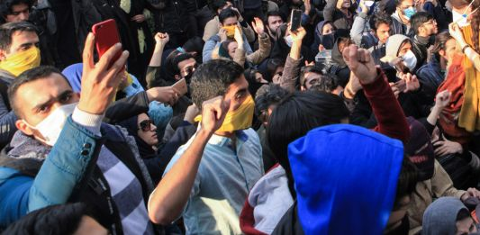 Students gathering in protest (© AP Images)