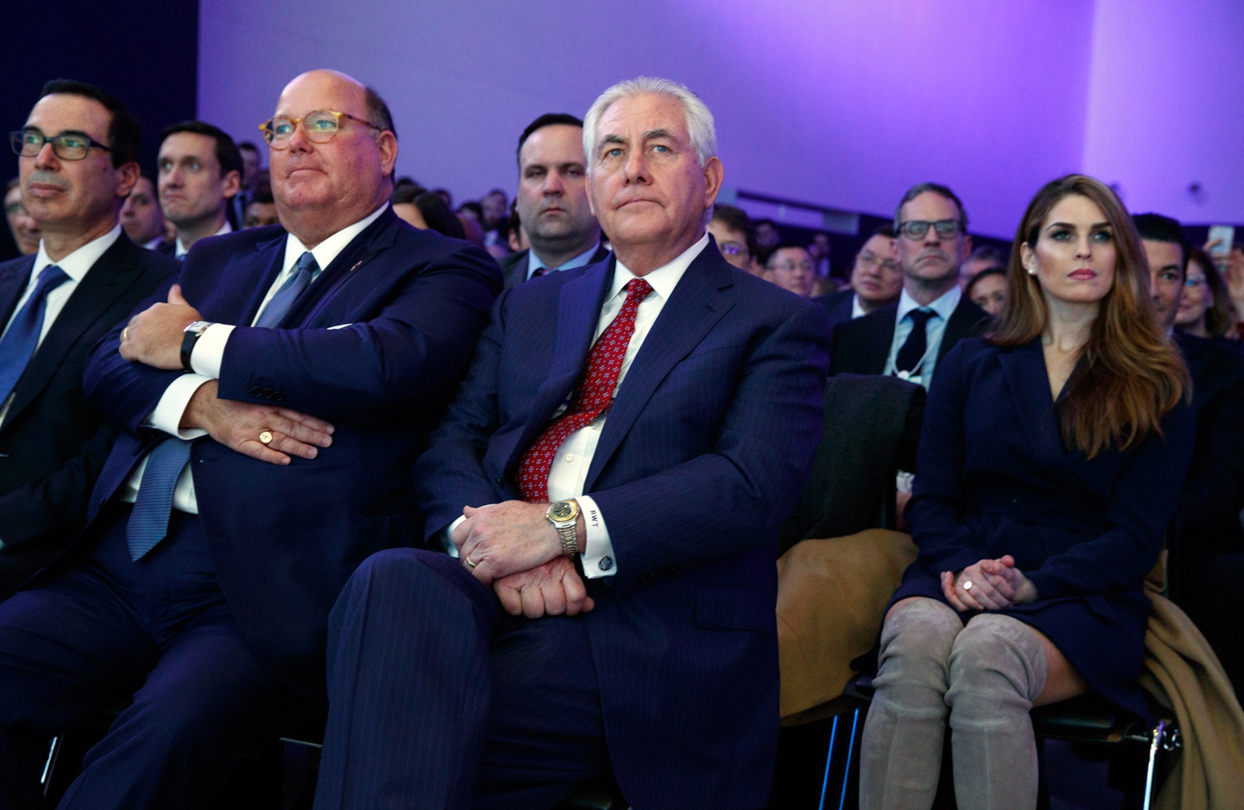 Rex Tillerson (center) sitting in an audience (© AP Images)