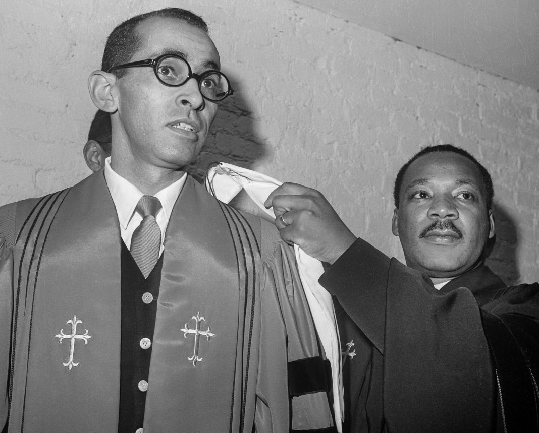 Martin Luther King Jr. placing religious hood on Wyatt Tee Walker (© Bettmann/Getty Images)