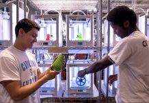 Two students inspecting 3-D object they made from printers (Johnny Andrews/UNC-Chapel Hill)