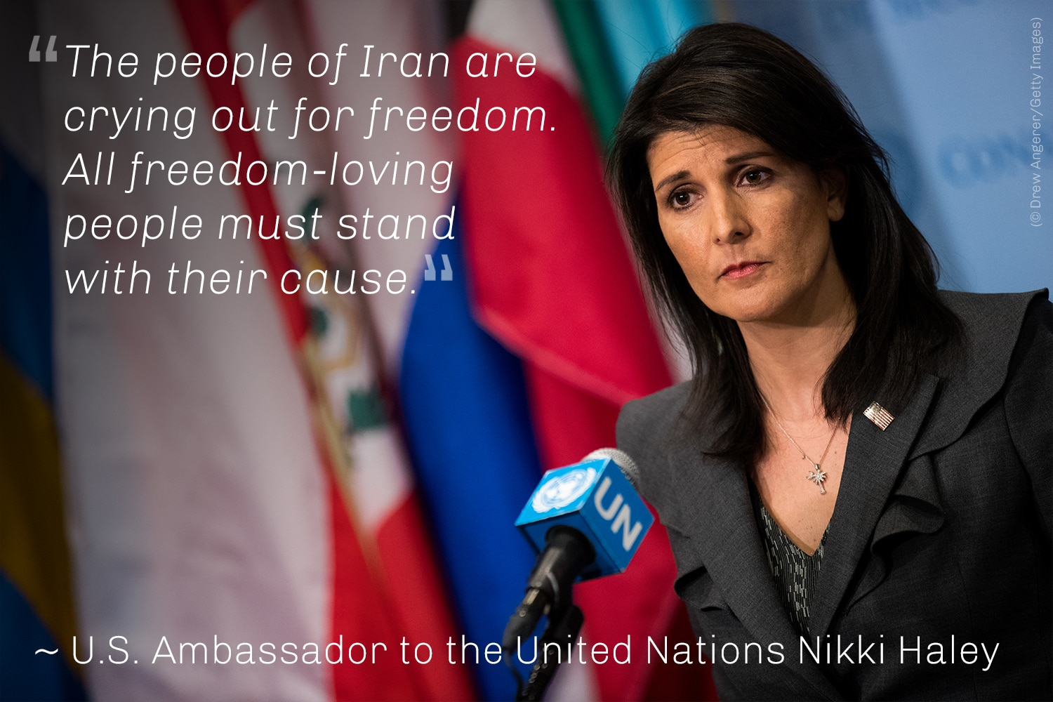 Nikki Haley at microphone with Haley quote (© Drew Angerer/Getty Images)