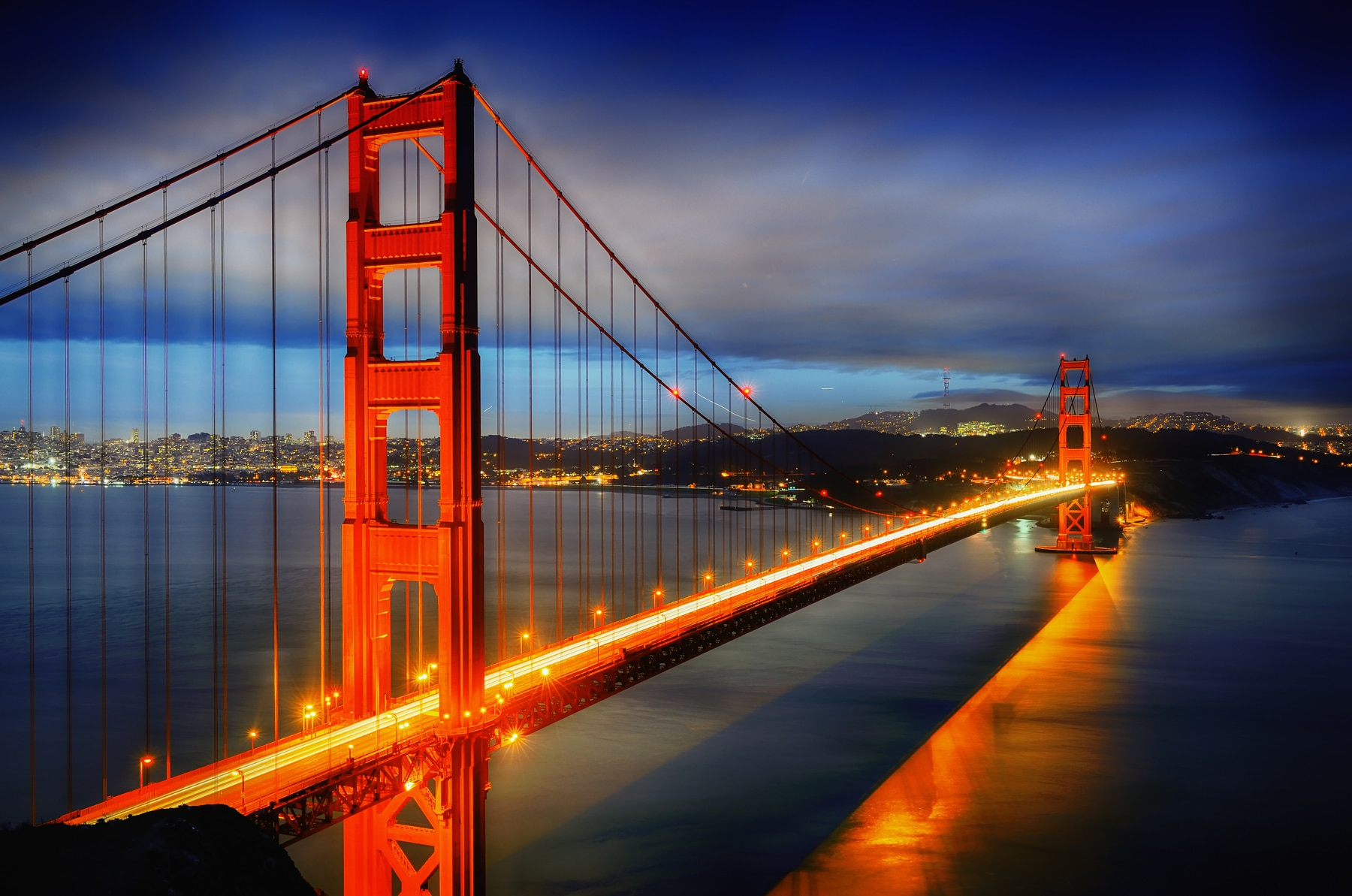 Red bridge illuminated at dusk (Shutterstock)
