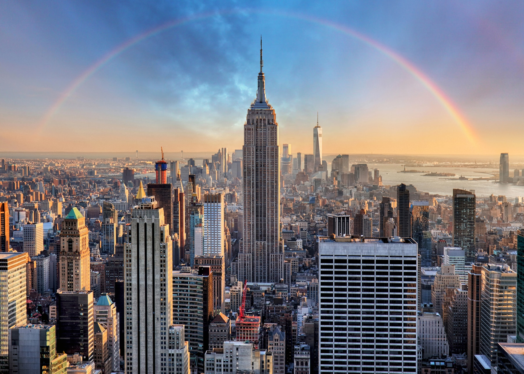 City skyline with skyscrapers and rainbow (Shutterstock)