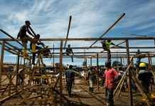Construction crew working on structure (Morgana Wingard/USAID)