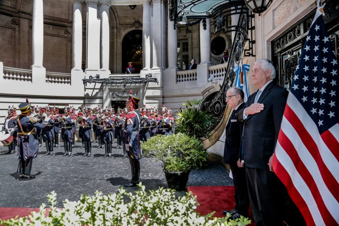 Tillerson standing at attention with a military guard (State Dept./Jorge Gomez)