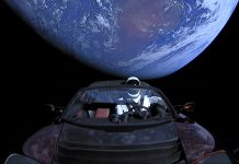Mannequin in spacesuit sitting in car flying beyond Earth's orbit (SpaceX)