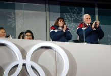 Vice President and Mrs. Pence applauding at the Olympics (© AP Images)