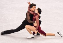 Two skaters hugging (© Roberto Schmidt/AFP/Getty Images)