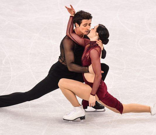 Two skaters hugging (© Roberto Schmidt/AFP/Getty Images)