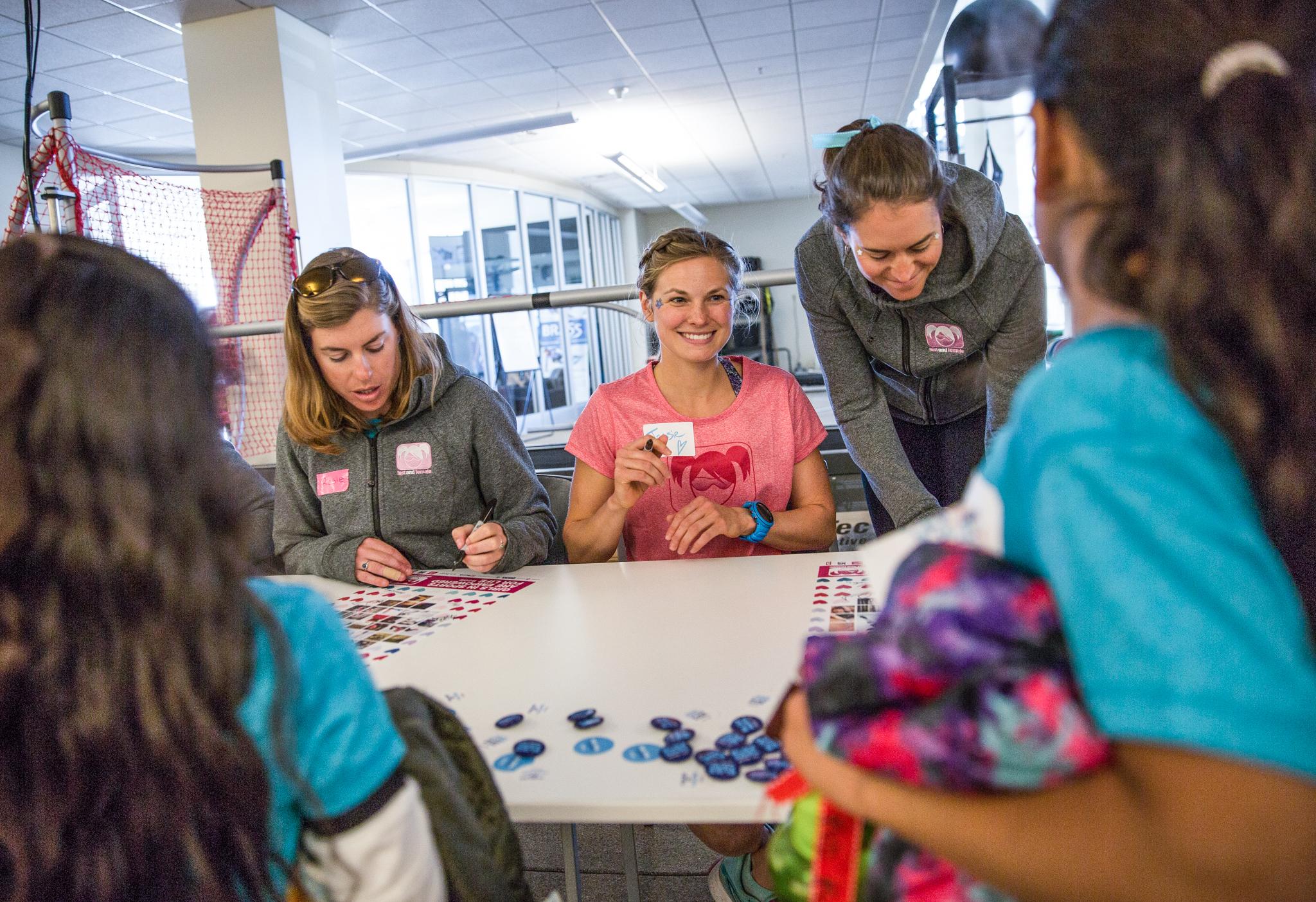 Women and girls working at table (© U.S. Ski & Snowboard)