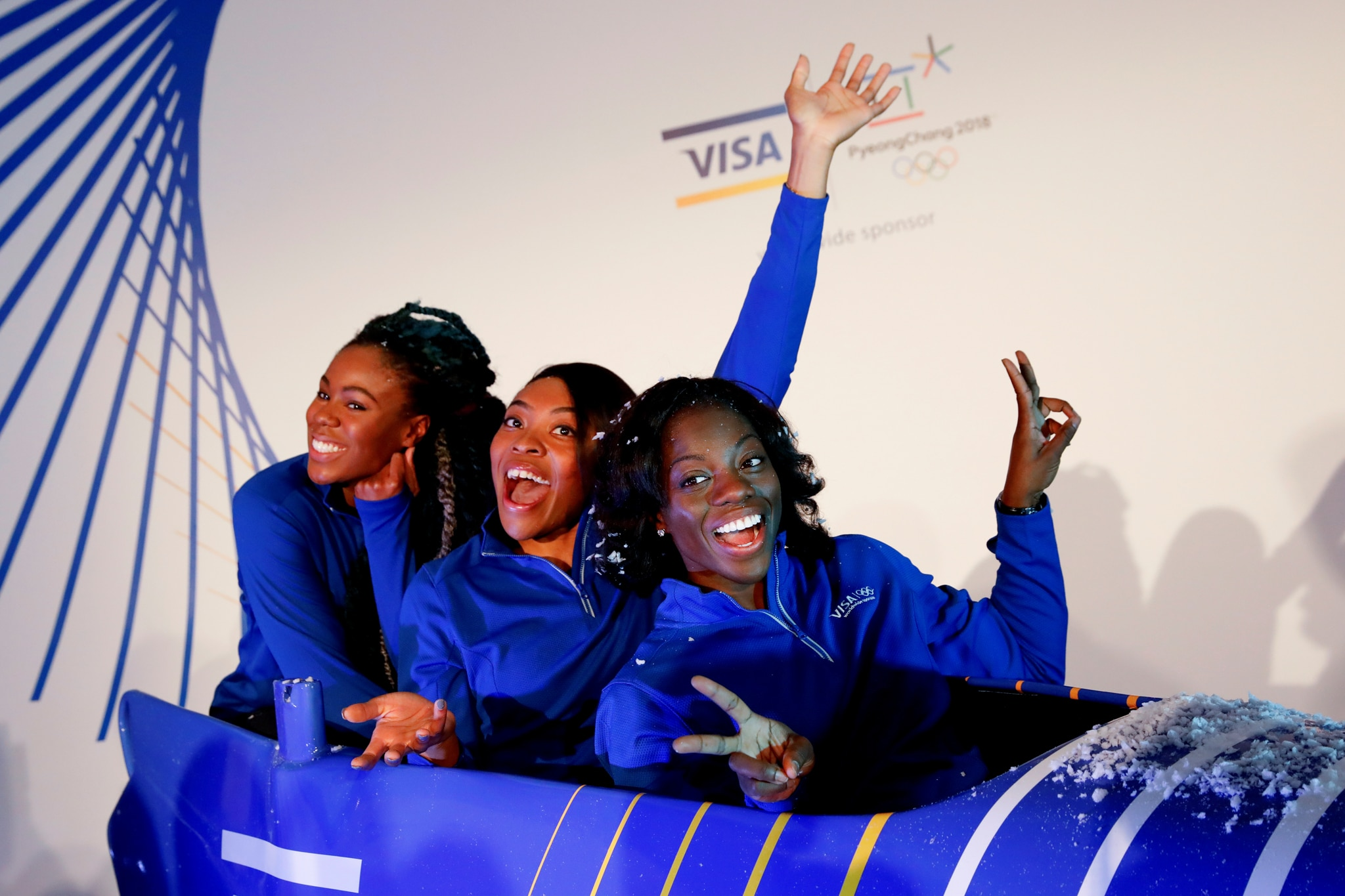 Three women posing in bobsled (© Shannon Stapleton/Reuters)