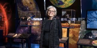 Susan Finley standing in front of NASA space museum exhibits (© Emily Berl)